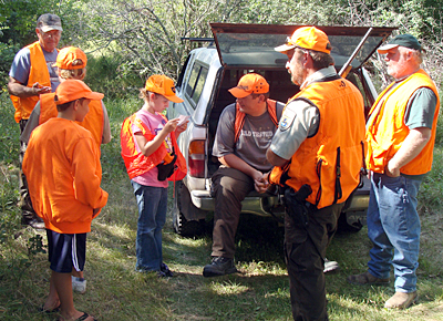 Jr. wardens with deer hunters Image